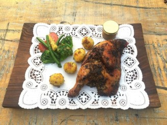 CHICKEN A LAST BARCELONA STYLE ROASTED IN CHARCOAL SERVED WITH POTATOES AND VEGETABLES (NV)