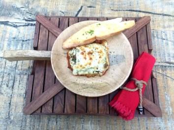 Homemade lasagna with vegetables and fresh mozarella (v)